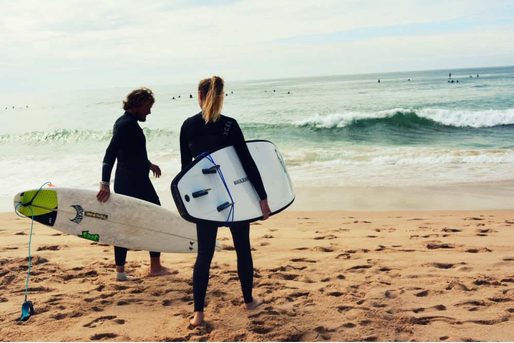 two-surfers-together