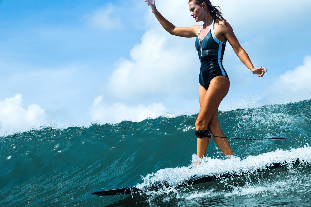 beautiful-girl-riding-surf-board-waves