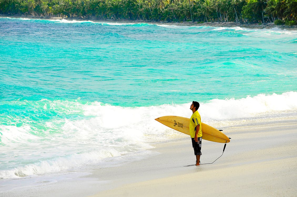 Surfer with pintail surfboard